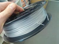 Катушка пластика Flexible FlexPolyEster 45D серебристый 1.75 мм 0,5 кг.